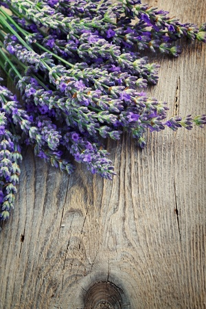 herbs of provence: Fresh lavender over wooden background Stock Photo