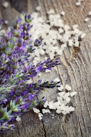 Spa setting with Fresh lavender over wooden background with bath salt photo
