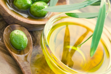 cooking oil: Extra virgin healthy Olive oil with fresh olives on rustic wooden background Stock Photo