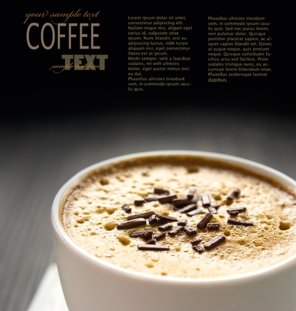 Capuccino in white cup  with chocolate sprinkles photo