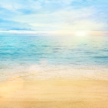 Beaqutiful sea background. Golden sand with blue ocean and cloudscape in the back.