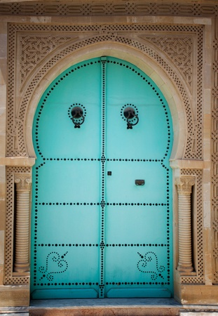 Blue wooden door in arabic style. Traditional arabic arhitecture