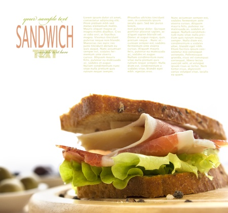 ham sandwich: Prosciutto and cheese sandwich with olives and lettuce.