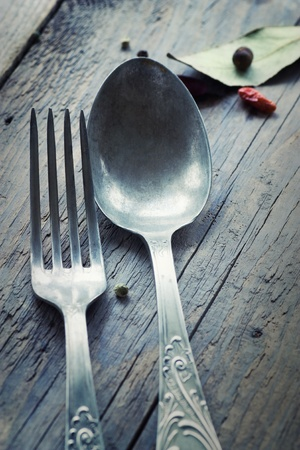 Fork and knife in rustic country setting photo