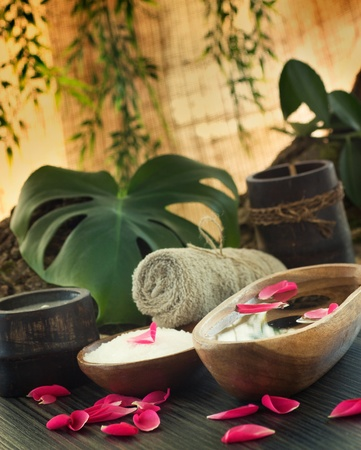 Natural spa setting with rose water and towel. Stock Photo
