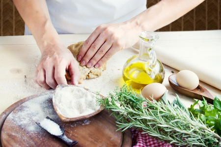 Woman is kneading dough balls. photo