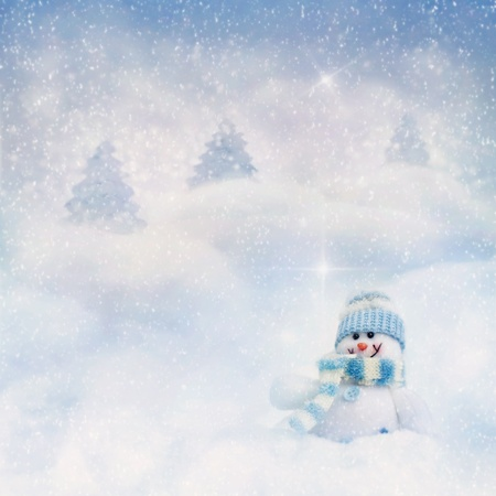 Snowman toy on the bokeh winter background photo