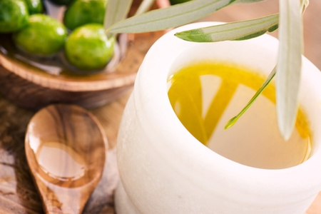 extra virgin: Extra virgin healthy Olive oil with fresh olives on rustic wooden background Stock Photo