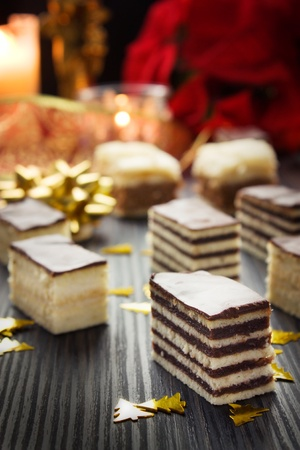 square cut: Various cake pieces of chocolate and vanilla filling.  Christmas decoration