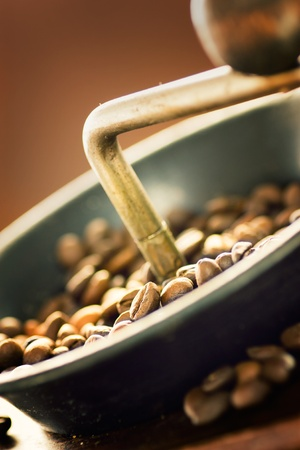 Coffee beans in the rustic old coffee grinder. Stock Photo - 11189954