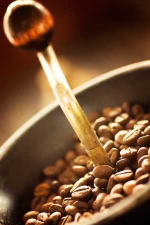 Coffee beans in the rustic old coffee grinder. photo