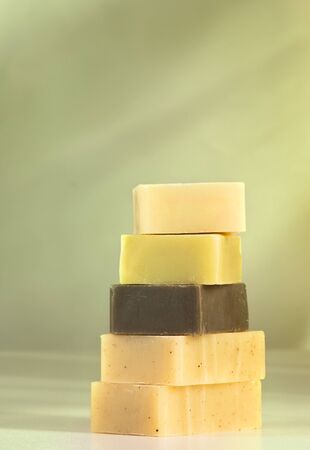 soap sud: Handmade natural soaps aranged in a pile Stock Photo