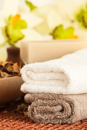 Spa setting with orchid and towels photo