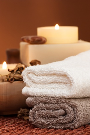 scented candle: Spa setting with towels and candle Stock Photo