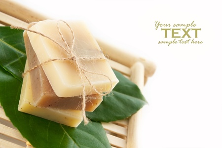 soap sud: Spa setting with natural soaps.Focus is on the bow.