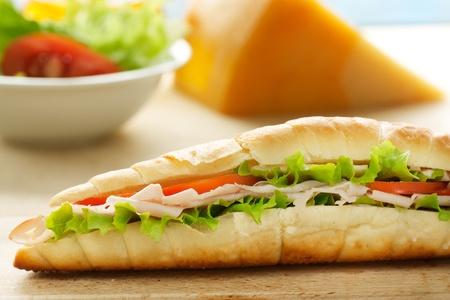 cold cut: Ham and cheese sandwich with lettuce and tomato.