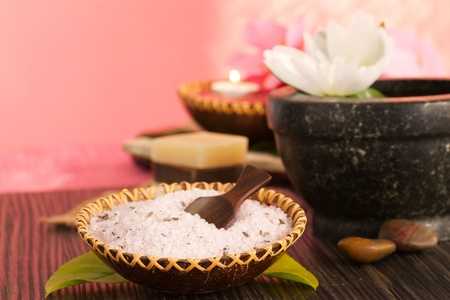 Spa setting  in pink tones with natural soaps and bath salt photo