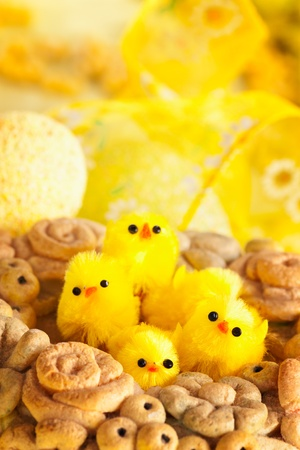 Easter setting with Easter eggs and chicks photo