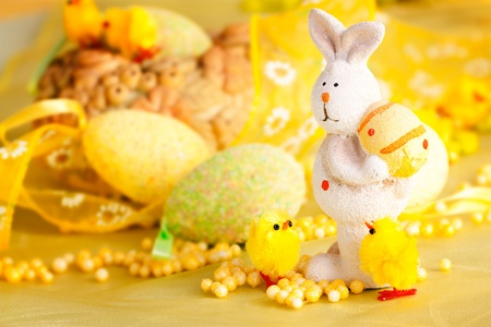 Easter setting with Easter eggs, chicks and rabbit. photo