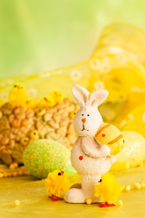 chicken nest: Easter setting with Easter eggs, chicks and rabbit. Stock Photo