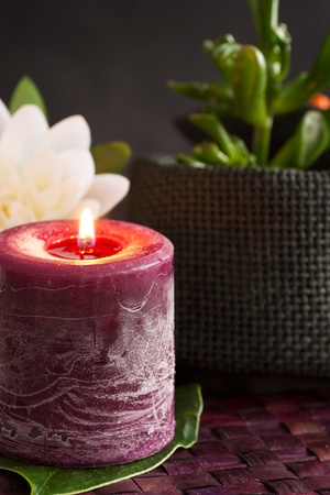 Spa setting with candle and lotus flower.. photo