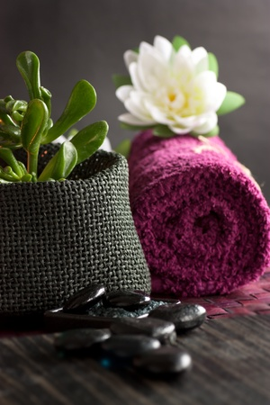 scented candle: Spa setting  with massage stones and towel. Stock Photo