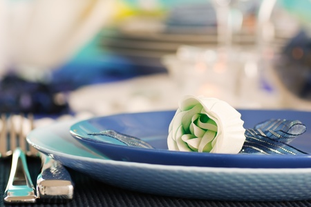 Blue table setting for romantic dinner with rose. photo