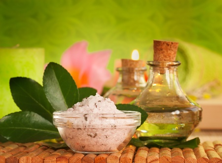 massage oil: Spa setting with bath salt and floral water
