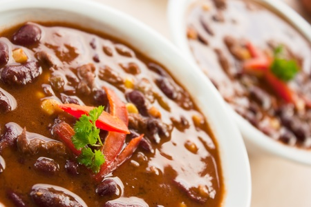 Chilli con carne with red pepper and parsley photo