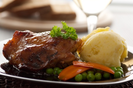 Baked chicken with mashed potatoes, peas and carrots photo