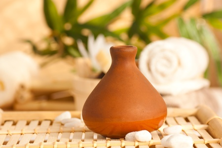 Spa setting with clay pot diffuser  with essentail oils. photo
