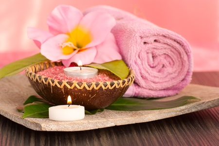 towel  spa  bathroom: Spa setting  in pink tones with candles Stock Photo