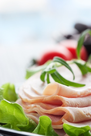 Slices of ham on lettuce with rosemary. Stock Photo - 11226230