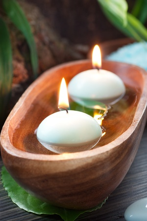 shui: Spa setting with water for treatment and flowers.