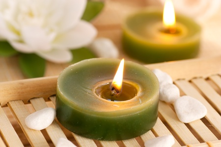 feng: Spa setting withcandles, waterlily and pebbles