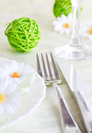 Spring table setting with flowers and decoration photo