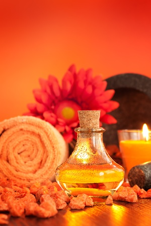 Spa setting  in orange tones  with candles photo