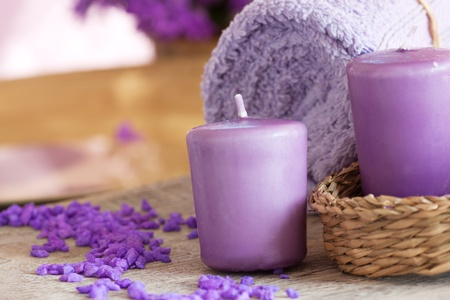 lila: Spa setting with candle and towel Stock Photo