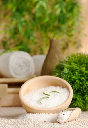 Spa setting with bath salt and towel. photo