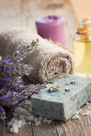 Spa setting with lavender, towel and natural soap photo
