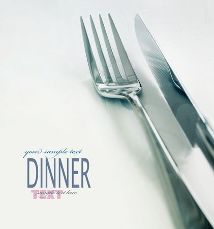 wedding table setting: Restaurant menu series. Wedding or dinner table place setting. Fork and knife and glass in elegant setting with copyspace