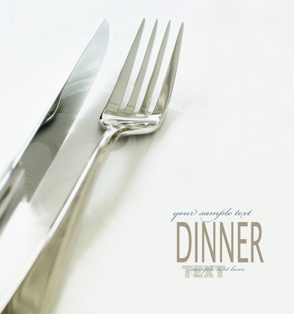 dinner table: Restaurant menu series. Wedding or dinner table place setting. Fork and knife and glass in elegant setting with copyspace