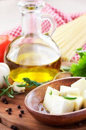 Feta cheese sllices with olive oil and rosemary photo