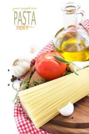 Italian Pasta with cooking ingredients. Spaghetti with olive oil, garlic and rosemary photo