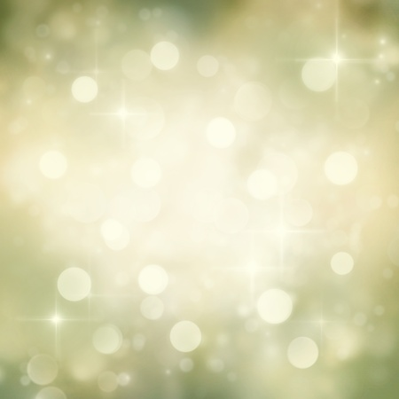 bokeh background: Festive gold Christmas abstract  background with bokeh lights and stars.