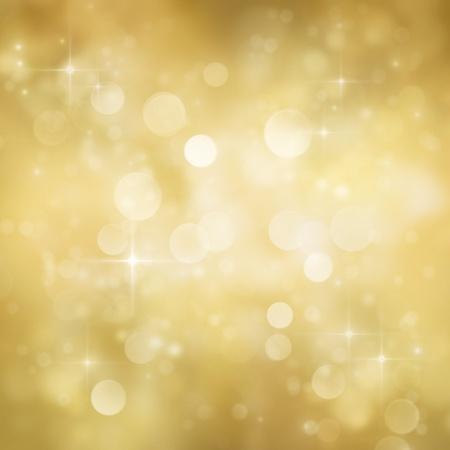 Festlig guld jul abstrakt bakgrund med bokeh ljus och stjärnor.