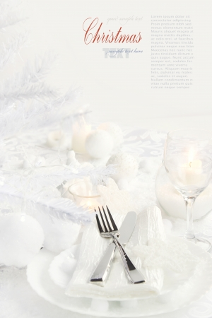 plate setting: Restaurant series with copyspace. Christmas dinner with table setting in white and holiday ornaments