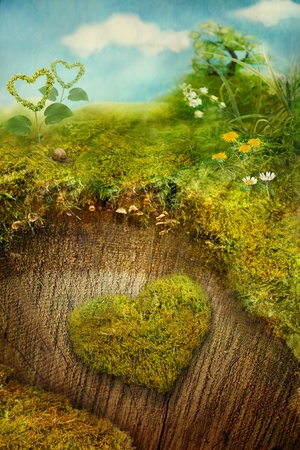 Valentines day holiday card with nature. Heart made of moss on a tree bark with miniature landscape and spring symbols.