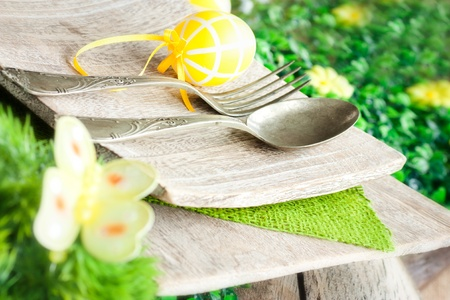 Restaurant menu series. Easter place setting. Fork and knife in rustic country table setting photo