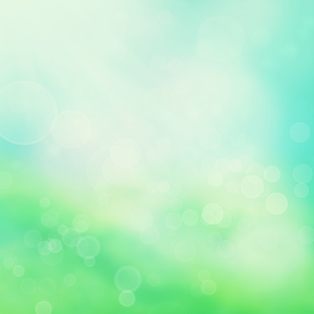 Spring or summer abstract nature background with grass in the meadow and blue sky in the back Stock Photo - 12440790